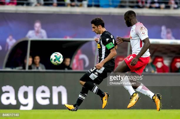 Lars Stindl of Borussia Moenchengladbach is chased by Dayot Upamecano of RB Leipzig during the Bundesliga match between RB Leipzig and Borussia...