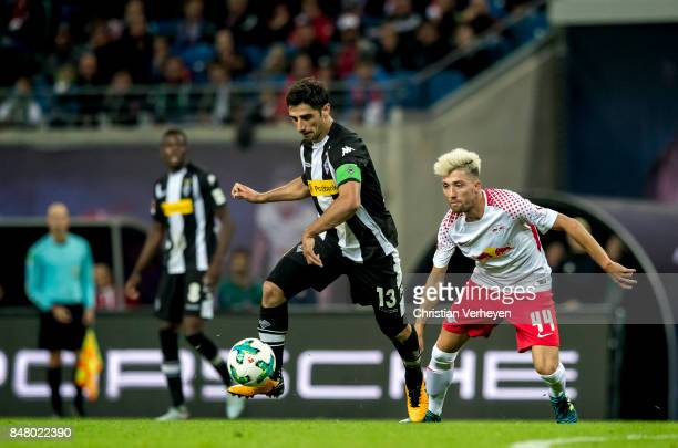 Lars Stindl of Borussia Moenchengladbach is chased by Kevin Kampl of RB Leipzig during the Bundesliga match between RB Leipzig and Borussia...