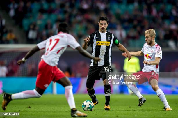 Lars Stindl of Borussia Moenchengladbach is chased by Konrad Laimer of RB Leipzigduring the Bundesliga match between RB Leipzig and Borussia...