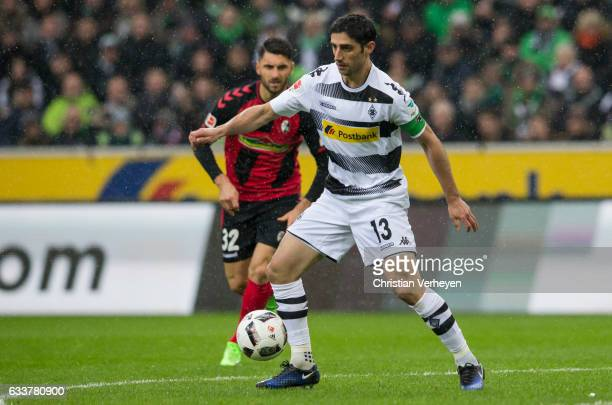 Lars Stindl of Borussia Moenchengladbach is chased by Vincenzo Grifo of SC Freiburg during the Bundesliga Match between Borussia Moenchengladbach and...