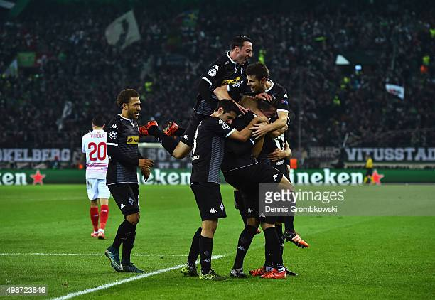 Lars Stindl of Borussia Moenchengladbach is mobbed by team mates in celebration as he scores their first goal during the UEFA Champions League Group...