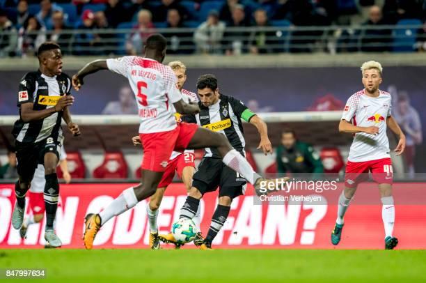Lars Stindl of Borussia Moenchengladbach scores his teams second goal during the Bundesliga match between RB Leipzig and Borussia Moenchengladbach at...