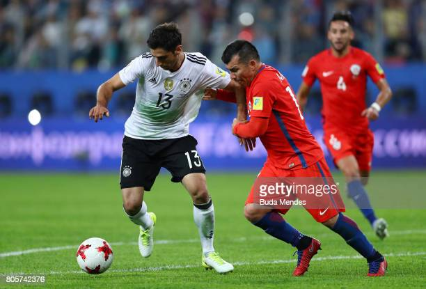 Lars Stindl of Germany and Gary Medel of Chile compete for the ball during the FIFA Confederations Cup Russia 2017 Final between Chile and Germany at...