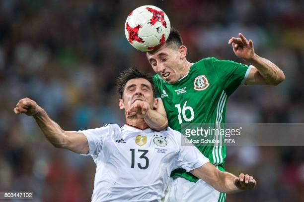 Lars Stindl of Germany and Hector Herrera of Mexico head the ball during the FIFA Confederations Cup Russia 2017 SemiFinal match between Germany and...