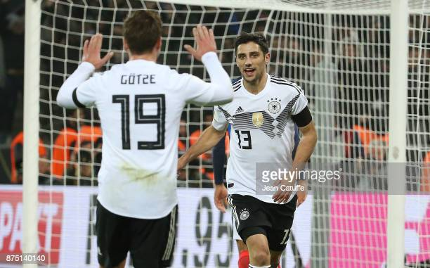 Lars Stindl of Germany celebrates his goal with Mario Goetze during the international friendly match between Germany and France at...
