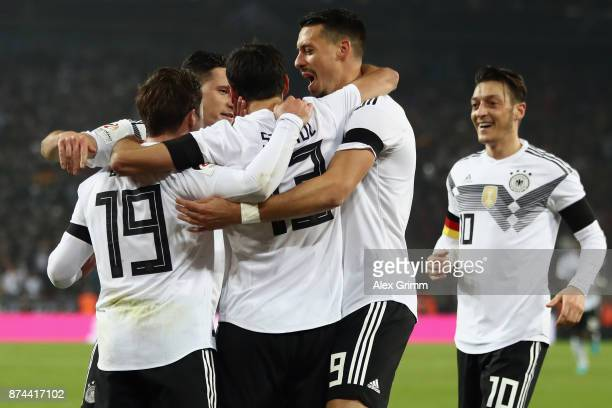 Lars Stindl of Germany celebrates his team's second goal with team mates Mario Goetze Sandro Wagner and Mesut Oezil during the international friendly...