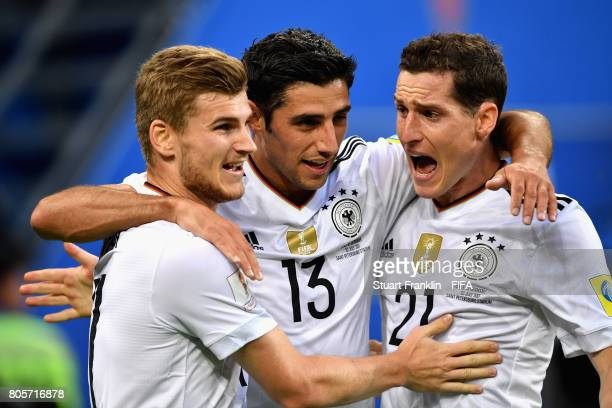 Lars Stindl of Germany celebrates scoring his sides first goal with Timo Werner of Germany and Sebastian Rudy of Germany during the FIFA...