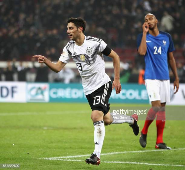 Lars Stindl of Germany celebrates scoring his sides second goal during the international friendly match between Germany and France at...