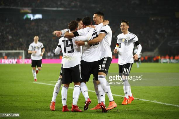 Lars Stindl of Germany celebrates scoring his sides second goal with his team mates during the international friendly match between Germany and...