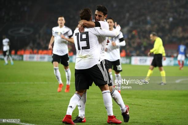 Lars Stindl of Germany celebrates scoring his sides second goal with Mario Gotze of Germany during the international friendly match between Germany...