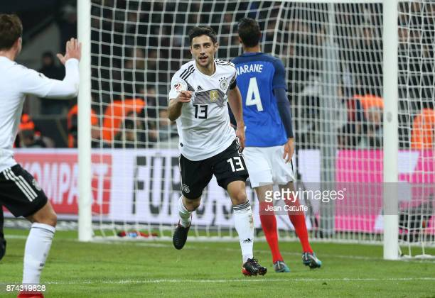 Lars Stindl of Germany celebrates scoring the tying goal at the last minute during the international friendly match between Germany and France at...