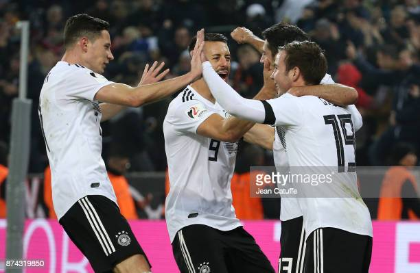 Lars Stindl of Germany celebrates with Julian Draxler Sandro Wagner Mario Gotze scoring the tying goal at the last minute during the international...