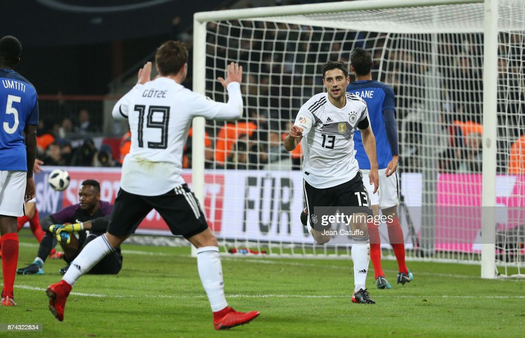 Lars Stindl of Germany celebrates with Mario Gotze scoring the tying goal at the last minute during the international friendly match between Germany and France at RheinEnergieStadion on November 14, 2017 in Cologne, Germany.