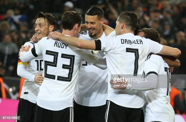 Lars Stindl of Germany celebrates with Mesut Ozil Sandro Wagner scoring the tying goal at the last minute during the international friendly match...