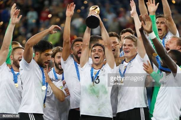 Lars Stindl of Germany national team lifts up the trophy as Germany national team players celebrate during award ceremony after FIFA Confederations...
