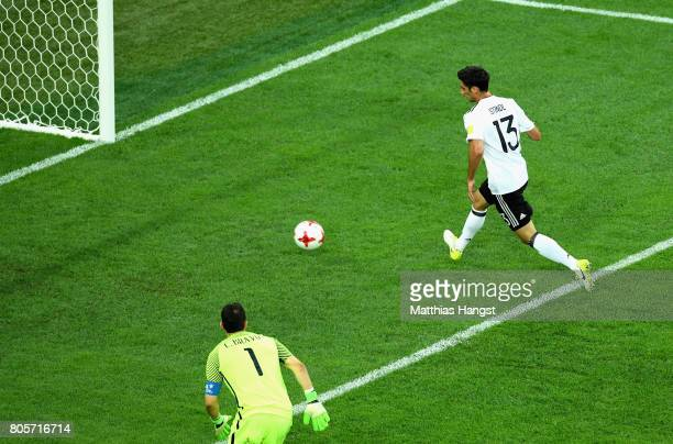 Lars Stindl of Germany scores his sides first goal as Claudio Bravo of Chile looks on during the FIFA Confederations Cup Russia 2017 Final between...