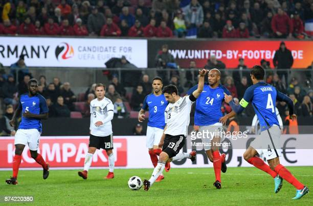Lars Stindl of Germany scores his sides second goal during the international friendly match between Germany and France at RheinEnergieStadion on...