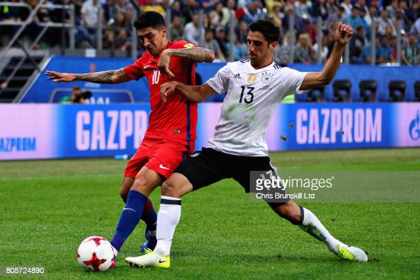 Lars Stindl of Germany tackles Pablo Hernandez of Chile during the FIFA Confederations Cup Russia 2017 Final match between Chile and Germany at Saint...