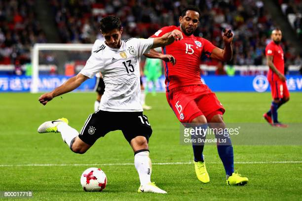 Lars Stindl of Germany takes a shot while he is challenged by Jean Beausejour of Chile during the FIFA Confederations Cup Russia 2017 Group B match...