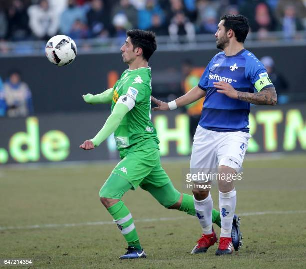 Lars Stindl of Gladbach and Aytac Sulu of Darmstadt battle for the ball during the Bundesliga match between SV Darmstadt 98 and Borussia...