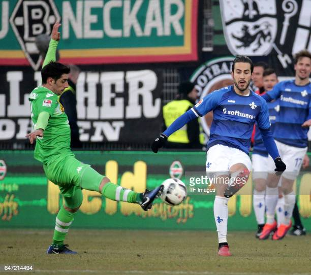 Lars Stindl of Gladbach and Mario Vrancic of Darmstadt battle for the ball during the Bundesliga match between SV Darmstadt 98 and Borussia...