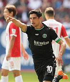 Lars Stindl of Hannover 96 celebrates after he scored the first goal during the Bundesliga match between FC Augsburg and Hannover 96 at SGL Arena on...