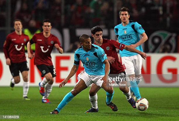 Lars Stindl of Hannover and William Vainqueur of Liege battle for the ball during the UEFA Europa League second leg round of 16 match between...