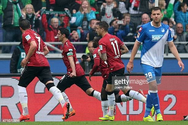 Lars Stindl of Hannover celebrates with his team mates after scoring his team's first goal during the Bundesliga match between Hannover 96 and 1899...