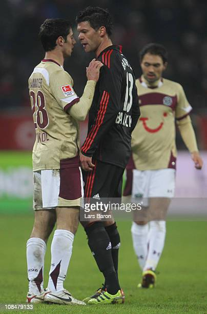 Lars Stindl of Hannover discusses with Michael Ballack of Leverkusen during the Bundesliga match between Bayer Leverkusen and Hannover 96 at BayArena...