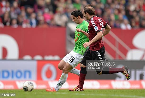 Lars Stindl of Hannover is challenged by Javier Pinola of Nuernberg during the Bundesliga match between 1 FC Nuernberg and Hannover 96 at Grundig...