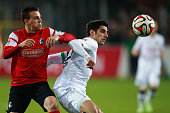 Lars Stindl of Hannover is challenged by Vladimir Darida of Freiburg during the Bundesliga match between SC Freiburg and Hannover 96 at...