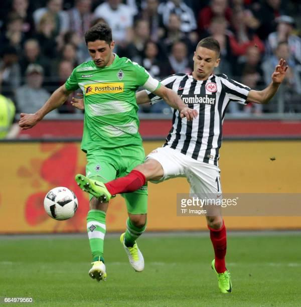 Lars Stindl of Mönchengladbach and Mijat Gacinovic of Frankfurt battle for the ball during the Bundesliga Match between Eintracht Frankfurt and...