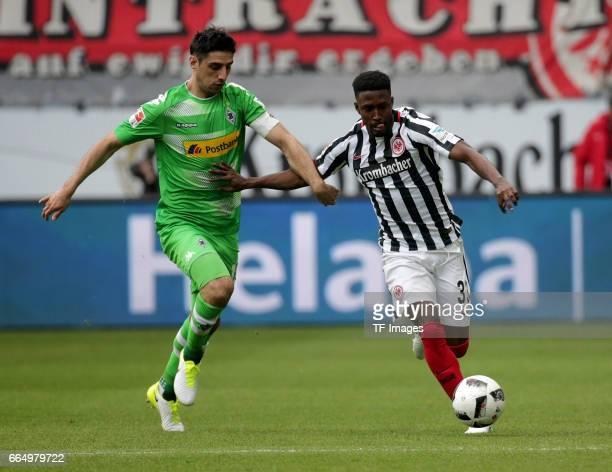 Lars Stindl of Mönchengladbach and Taleb Tawatha of Frankfurt battle for the ball during the Bundesliga Match between Eintracht Frankfurt and...