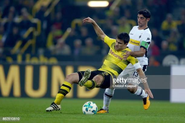 Lars Stindl of Mnchengladbach challenges Sokratis of Dortmund during the Bundesliga match between Borussia Dortmund and Borussia Moenchengladbach at...