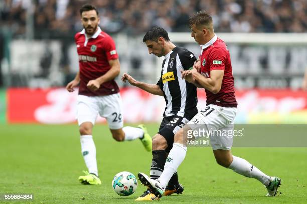 Lars Stindl of Moenchengladbach and Anton Waldemar of Hannover battle for the ball during the Bundesliga match between Borussia Moenchengladbach and...