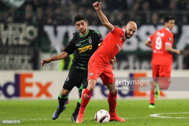 Lars Stindl of Moenchengladbach and Borja Valero of Fiorentina battle for the ball during the UEFA Europa League Round of 32 first leg match between...