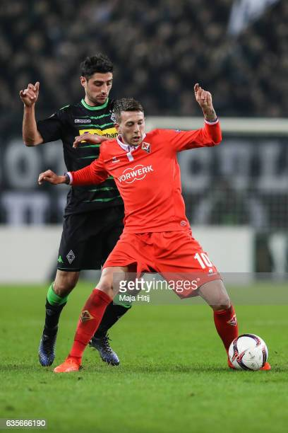 Lars Stindl of Moenchengladbach and Federico Bernardeschi of Fiorentina battle for the ball during the UEFA Europa League Round of 32 first leg match...