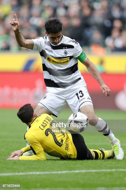 Lars Stindl of Moenchengladbach and Gonzalo Castro of Dortmund battle for the ball during the Bundesliga match between Borussia Moenchengladbach and...