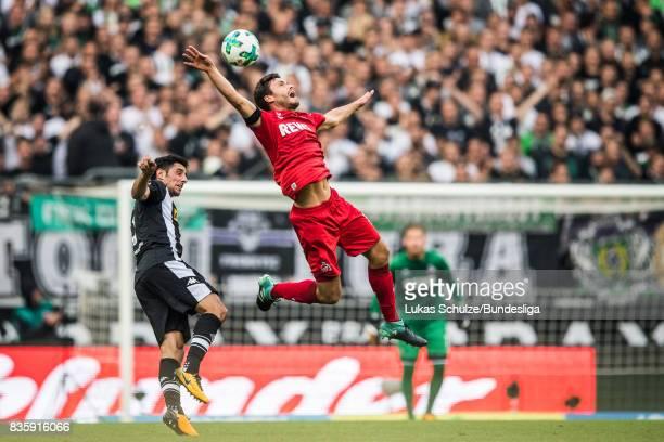 Lars Stindl of Moenchengladbach and Jonas Hector of Koeln head the ball during the Bundesliga match between Borussia Moenchengladbach and 1 FC Koeln...