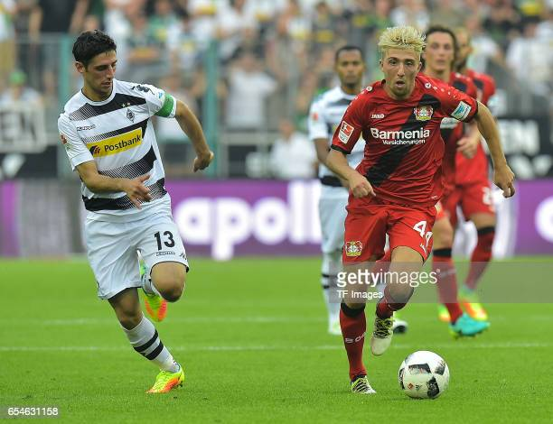 Lars Stindl of Moenchengladbach and Kevin Kampl of Leverkusen battle for the ball during the Bundesliga match between Borussia Moenchengladbach and...
