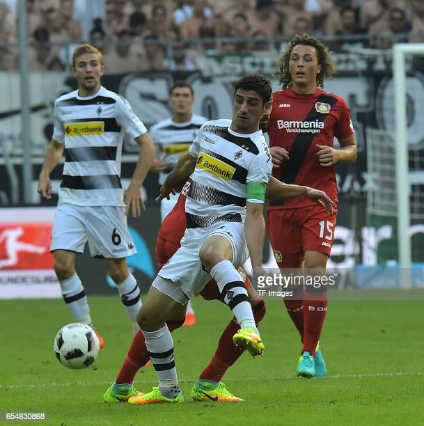 Lars Stindl of Moenchengladbach and Ömer Toprak of Leverkusen and Julian Baumgartlinger of Leverkusen battle for the ball during the Bundesliga match...