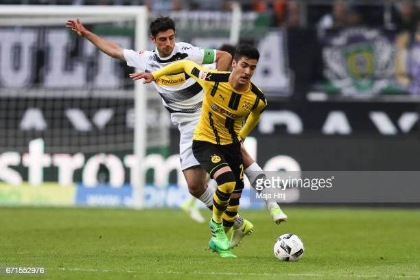 Lars Stindl of Moenchengladbach and Mikel Merino Zazon of Dortmund battle for the ball during the Bundesliga match between Borussia Moenchengladbach...