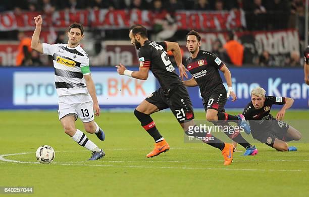 Lars Stindl of Moenchengladbach and Oemer Toprak Hakan Calhanoglu and Kevin Kampl battle for the ball during the Bundesliga match between Bayer 04...