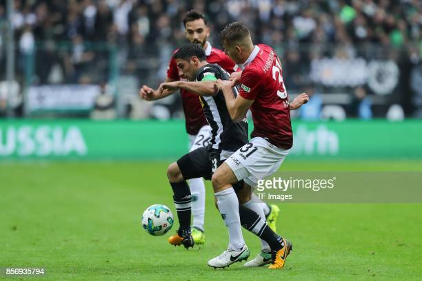 <Lars Stindl of Moenchengladbach and Waldemar Anton of Hannover battle for the ball during the Bundesliga match between Borussia Moenchengladbach and...