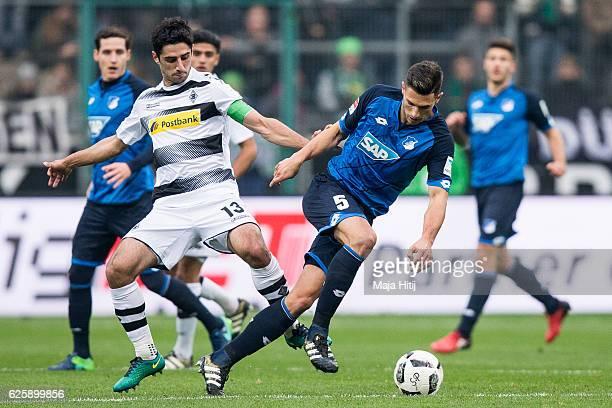Lars Stindl of Moenchengladbach battles for the ball with Fabian Schaer of Hoffenheim during the Bundesliga match between Borussia Moenchengladbach...