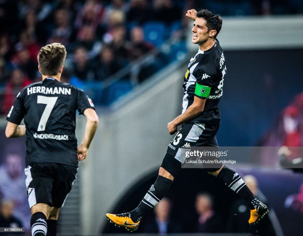 Lars Stindl (R) of Moenchengladbach celebrates his goal during the Bundesliga match between RB Leipzig and Borussia Moenchengladbach at Red Bull Arena on September 16, 2017 in Leipzig, Germany.