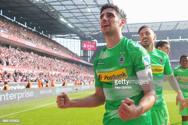 Lars Stindl of Moenchengladbach celebrates his team's third goal during the Bundesliga match between 1 FC Koeln and Borussia Moenchengladbach at...