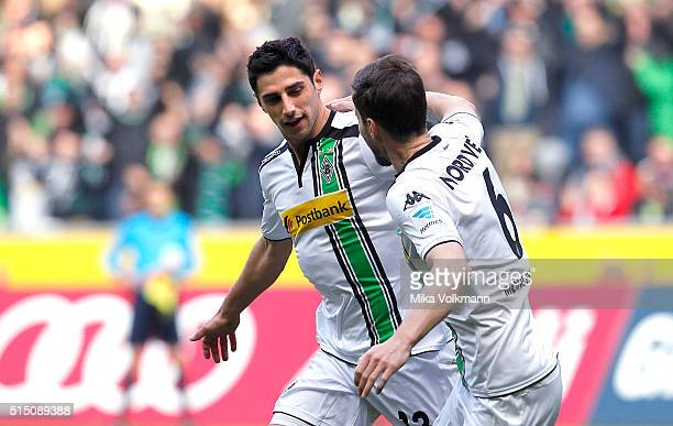 Lars Stindl of Moenchengladbach celebrates scoring the 10 goal with Havard Nordveit of Moenchengladbach during the Bundesliga match between Borussia...