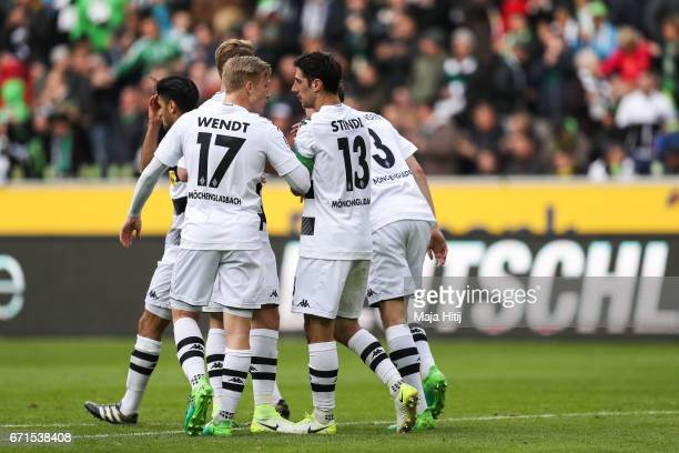 Lars Stindl of Moenchengladbach celebrates with his teammates after scoring goal to make it 11 during the Bundesliga match between Borussia...