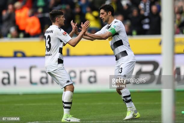 Lars Stindl of Moenchengladbach celebrates with Jonas Hofmann after scoring goal to make it 11 during the Bundesliga match between Borussia...